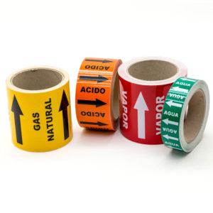 Marcador de tuberías con flechas y texto para indicar sustancia y sentido